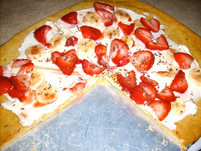 Sweet pizza with strawberries and bananas